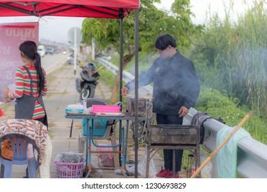 Chiang Rai THAILAND - 11: 13: 2018: women selling pork are take photo as a souvenir in Chiang Rai Thailand.