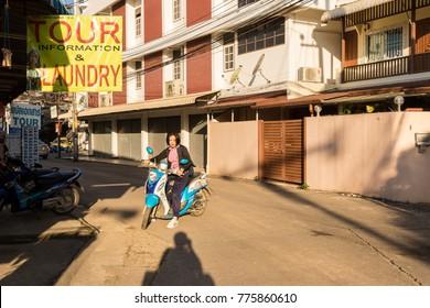 Chiang Rai - THAILAND: 12: 13: 2017:Tourist rides a motorbike in Chiang Rai - THAILAND