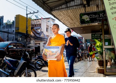 Chiang Rai THAILAND - 12: 14: 2017 :Buddhist monk walks In The Landmark street in Chiang Rai Thailand.