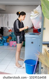 Chiang Rai THAILAND - 2: 6: 2018: A female employee was working in a laundromat  in Chiang Rai Thailand.