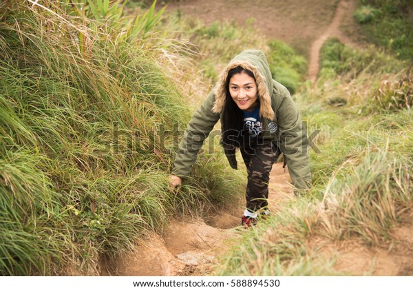 Chiang rai Thailand - 22 January 2017: Young woman walking a trail in mountains  at phu chi fah Chiang Rai, Thailand