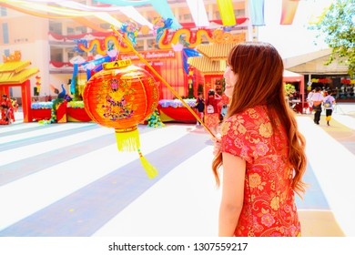 Chiang Rai THAILAND -2:6:2019:uniform people asian beautiful girl holding chinese new year lanterns in china town