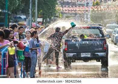 Chiang Rai, Thailand - April 12, 2015 : The Songkran festival or Thai New Year's festival . Songkran is the holiday  known for its water festival. Water fights in the town.
