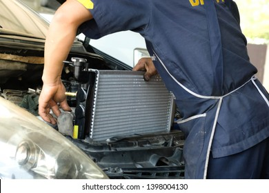 Chiang rai, Thailand - April 30,2019: Car radiator,The car technicians is changing the new radiator in the car.