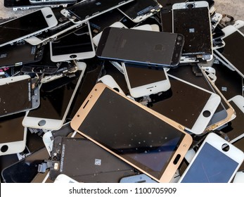 Chiang Rai, Thailand: August 23, 2017 - heap of broken smartphone screen (e-waste, electronic-waste)