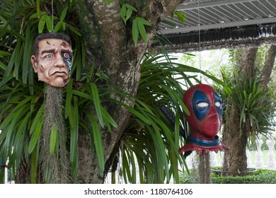 Chiang Rai / Thailand - August 23 2018: Action heroes hanging on a palm. Including pirates of Caribbean, Deadpool and Hulk. Just ripped heads of heroes from Marvel stories.