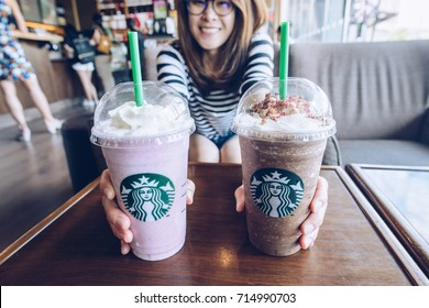 CHIANG RAI, THAILAND- August-27-2017 : A Venti Starbucks of frappuccino ACAI mixed berry yogurt and frappuccino Granola dark mocha in Starbucks coffee shop.