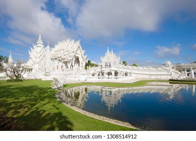CHIANG RAI, THAILAND - DECEMBER 16, 2018: Modern Buddhist temple Wat Rong Khun (White temple) on a sunny afternoon