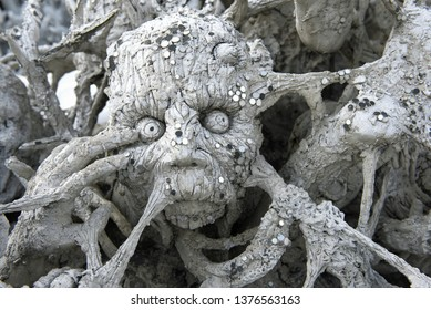 CHIANG RAI, THAILAND - DECEMBER 16, 2018: The sinner's head in hell close up. Fragment of design of the Buddhist temple of Wat Rong Khun (White temple)