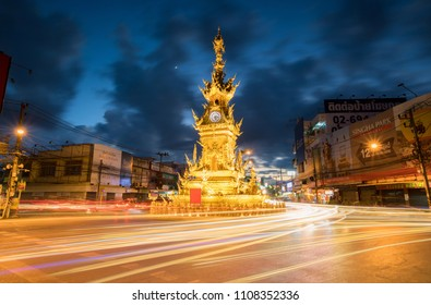 Chiang rai, Thailand, December 23, 2017 : The clock tower with light of car in December 23, 2017 at Chiang rai, Thailand.