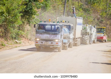 CHIANG RAI, THAILAND - FEBRUARY 01, 2018: Outdoor view of machinery for rail road construction in Chiang Mai, Thailand, working on a road construction site to smooth the ground