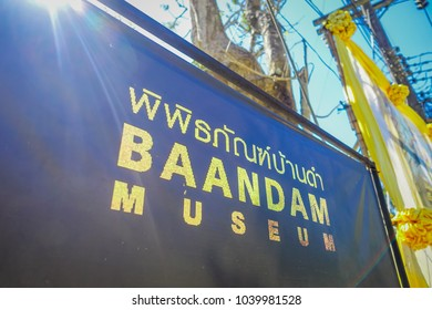 CHIANG RAI, THAILAND - FEBRUARY 01, 2018: Informative sign over a metallic structure of Baandam museum Black House, created and designed by Thawan Duchanee