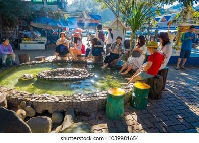 CHIANG RAI, THAILAND - FEBRUARY 01, 2018: Outdoor view of unidentified people washing and foot soak onsen, the tourist at Sankampaeng hot springs in San Kampang district, Chiang Mai, Thailand