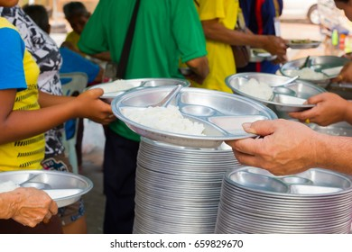 CHIANG RAI, THAILAND - FEBRUARY 19 : unidentified people holding rice on stainless steel tray on February 19, 2016 in Chiang rai, Thailand.
