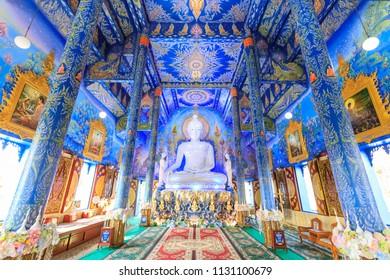 Chiang Rai, Thailand - February 20, 2018: The Blue Temple (Wat Rong Sear Tean), Buddha statue inside ordination hall or main chapel.