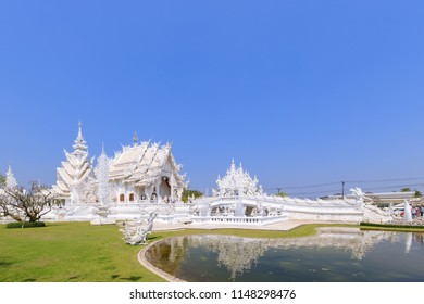 Chiang Rai, Thailand - February 20, 2018: Wat Rong Khun or White Temple, world famous destination. Designed by Master Chalermchai Kositpipat, National artist.