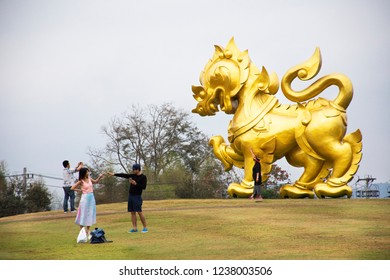 CHIANG RAI, THAILAND - FEBRUARY 21 : Gold Singha statue on hill for traveler people travel visit and take photo in Singha Park at Chiangrai city in morning on February 21, 2018 in Chiang Rai, Thailand