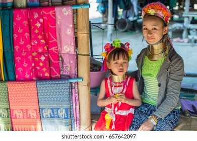 CHIANG RAI, THAILAND - FEBRUARY 4: Karen long neck mother and child on February 4, 2016 in a village outside Chiang Rai. Karen is one of several ethnic hill tribes in northern Thailand.