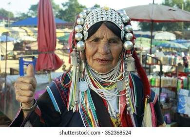 CHIANG RAI, THAILAND - JAN4: Unidentified Akha tribe elderly woman with traditional clothes and silver jewelery in hill tribe minority village and market on January 3, 2014. Doi Mae Salong, Thailand.