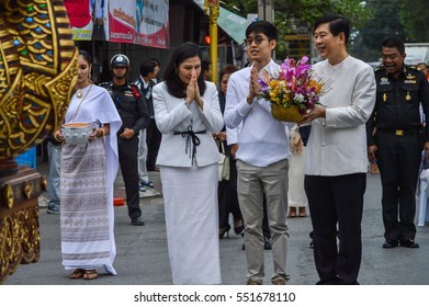 Chiang Rai, Thailand : January 1, 2017. New Year Food Offerings Festival of traditional merit making ceremony, Chiang Rai city mayor waiting for give flower to a Buddha image.