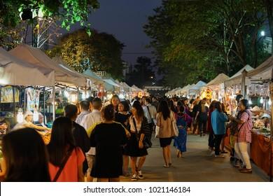 CHIANG RAI, THAILAND - JANUARY 20, 2018:  Tourists choose food at the Saturday Night Market street on Jauary 20, 2018 in Chiang Rai, Thailand.