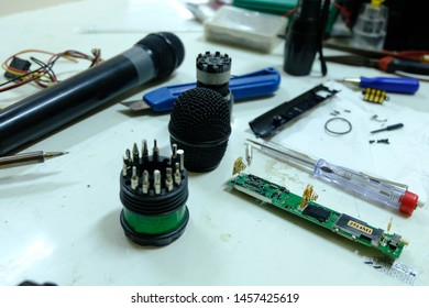 Chiang Rai, Thailand - July 4, 2019: Microphone repair,Close up of Microelectronics Soldering Lead Repairing Microphone Wire Technology Concept.