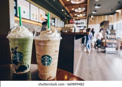 CHIANG RAI, THAILAND- July-02-2017 : A Venti Starbucks frappuccino Irish coffee and Green tea latte frappuccino in Starbucks coffee shop.