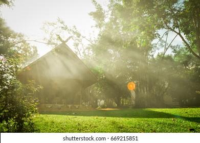 Chiang Rai, Thailand - June 23, 2017 : Drum Pavilion and sunbeam in Baandam Museum (Black House), created and designed by Thawan Duchanee.