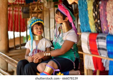 Chiang rai, Thailand - June 28, 2015 : Long-necked Karen mother was wearing tribal jewelry for her daughter in the morning.
