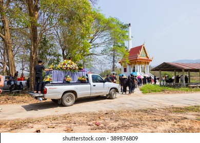 CHIANG RAI, THAILAND - MARCH 2 : pick-up carrying coffin to the tumb  for Christian funeral rites on March 2, 2016 in Chiang rai, Thailand.