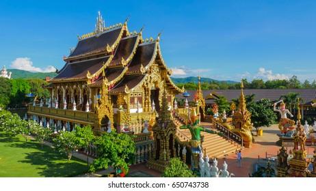 CHIANG RAI , THAILAND - MAY 14, 2017 : Golden Buddha and church at Wat Sang Kaew Photiyan is located at Morn Sang Kaew mountain Mai Suay district,Jedi Luang sub district in Chiang Rai