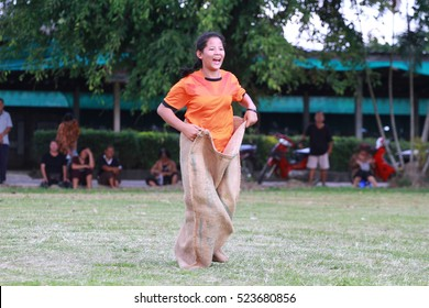 CHIANG RAI, THAILAND, NOV 25,2016: Girl playing sack running game on school's sports Day in Chiang Rai on November 25, 2016.
