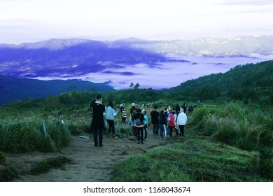 CHIANG RAI, THAILAND - November 11, 2017 tourists in the winter costumes Travel to the mountains. Phu Chi Fa or Phu Chee Fah in order to catch a glimpse of the sea of mist  the view of the fog surroun