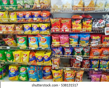 CHIANG RAI, THAILAND - NOVEMBER 28: various brand of Potato chips in packaging for sale on supermarket stand or shelf in Seven Eleven on November 28, 2016 in Chiang rai, Thailand