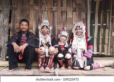 CHIANG RAI, THAILAND - OCT 1 : Akha family with traditional clothes and silver jewelery in akha hitt tribe minority village on October 1, 2011 in Chiang Rai, Thailand.