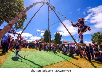 CHIANG RAI - THAILAND, SEPTEMBER 7, 2019 : Akha tribe playing with the wooden swing on Akha Swing Festival at Doi Mae Salong. The annual Akha Swing Festival is pretty much about women and fertility.