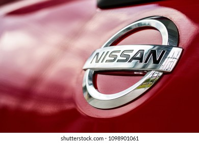 CHIANG RAI, THAILAND-APRIL 18, 2018, closeup logo nissan car with soft-focus and over light in the background