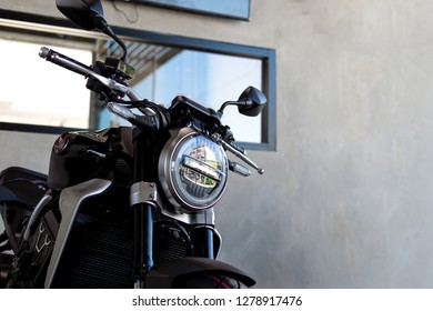 CHIANG RAI, THAILAND-DECEMBER 27, 2018, closeup honda NEO SPORTS CAFE CB1000R in bigbike showroom with soft-focus and over light in the background