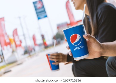Chiang Rai, Thailand-February 25, 2020,  Pepsi soft drink in man's hand with soft-focus and over light in the background