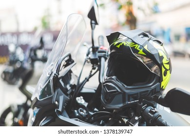 CHIANG RAI, THAILAND-MARCH 30, 2019 closeup helmet on honda bigbike with soft-focus and over light in the background
