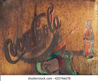 CHIANG RAI,THAILAND - MAY 12 : Old rust condition vintage wall of Coca Cola logo. on MAY 12, 2014 in Chiang Rai Thailand.