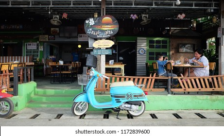 CHIANGKHAN,LOEI, THAILAND - CIRCA AUGUST, 2018 : Old Vespa Motorbike The restaurant was decorated at Chiang Khan Walking Street. City of Loei Province, Thailand