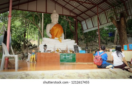 CHIANGKHAN,LOEI, THAILAND - CIRCA OCTOBER, 2018 :Tourists worship the statue at Wat Phra Phutthabat phu khway ngein temple in Chiang Khan District, Loei Province.Thailand.