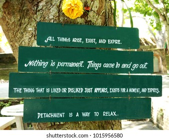 CHIANGMAI/ NORTHERN THAILAND-NOVEMBER 17, 2017: Buddhist doctrine on wooden board hanging on the tree in a temple, saying that all things arise, exit and expire. Nothing is permanent, Things come in a