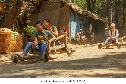 CHIANGMAI THAILAND - 12 FEBRUARY : Unidentified tourist play wooden sleigh wheeled  which vehicle of thailands tribal on 12 February 2016 at Mon jam Chiangmai, Thailand