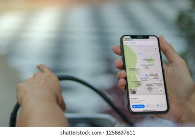 Chiangmai, THAILAND - 15 DEC 2018: Close up of man holding  iphone X, Google Maps is used to navigate a journey while driving. It is a free navigation service of the Google company - Image
