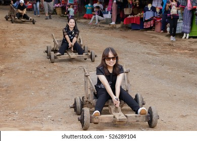 CHIANGMAI THAILAND - 17 NOVEMBER: Unidentified tourist play wooden sleigh wheeled  which vehicle of thailand's tribal on 17 November 2016 at Mon jam Chiangmai, Thailand