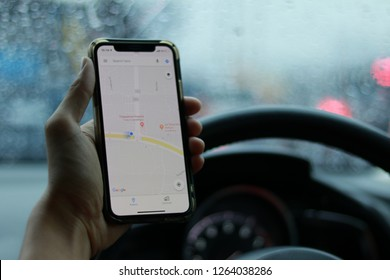 Chiangmai, THAILAND - 20 DEC 2018: male using Iphone X smartphone and using application Google Maps to destination. navigation service by Google company in car - Image
