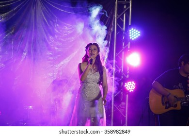 CHIANGMAI, THAILAND - 26 December 2015 : Miss. Maneerut (new singer form Chiangmai university) performs in Colony game at main stadium Chiangmai university on December 26, 2015 in Chiangmai, Thailand.