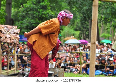 Chiangmai Thailand, 28 May 2018  A medium who communicates with Poo Sae Ya Sae, giant guardians of city eats raw meat and blood of buffalo for the ritual to show respect to the ghost  to protect them
